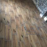 Wood effect floor tiles with drain tray in centre of floor